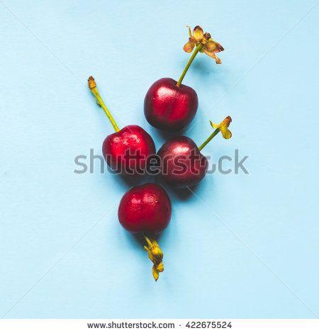 group of cherries on pastel trend background, minimal theme - stock photo