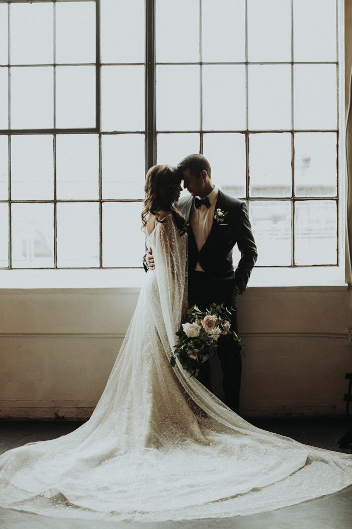 This fashion forward Moss Denver wedding is full of modern and classic details. India Earl photographed the couple's special day.