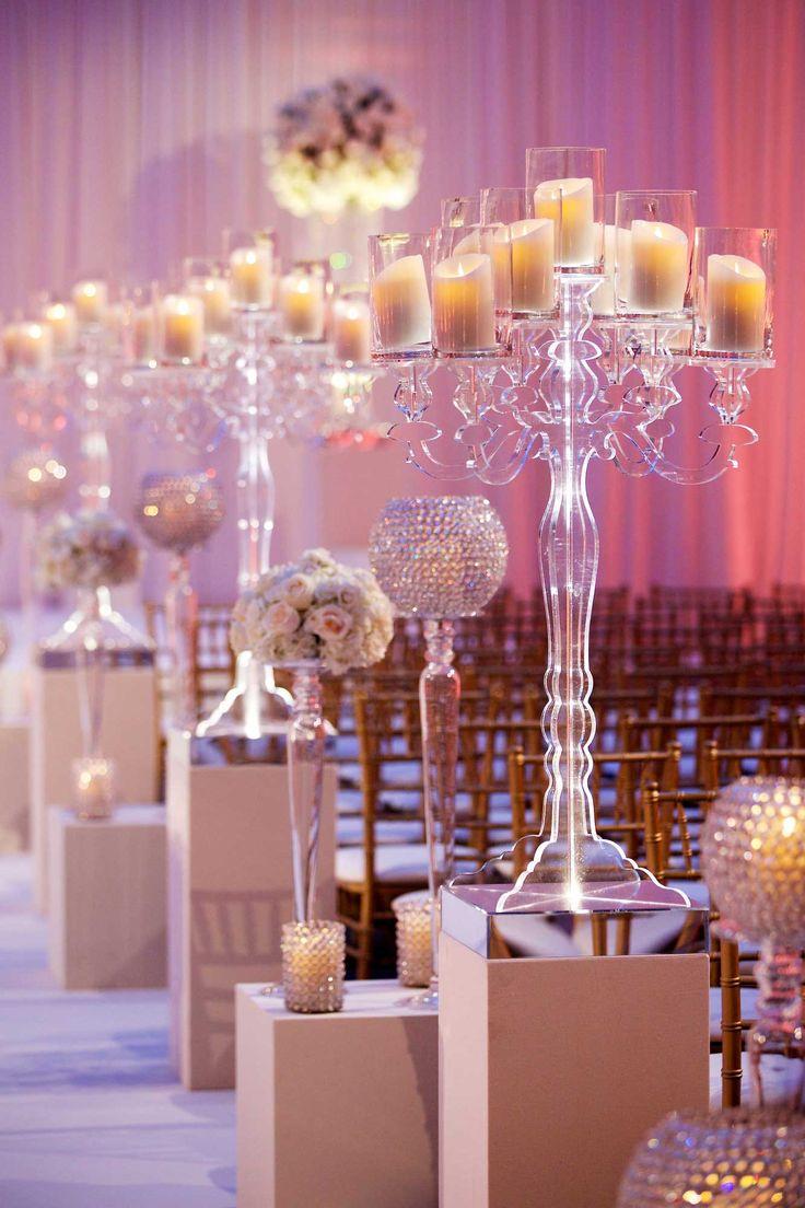 Lucite Candelabra Along Aisleway | Photography: Bob & Dawn Davis Photography. Read More: http://www.insideweddings.com/weddings/million-dollar-listing-miami-star-chad-carrolls-cleveland-wedding/732/