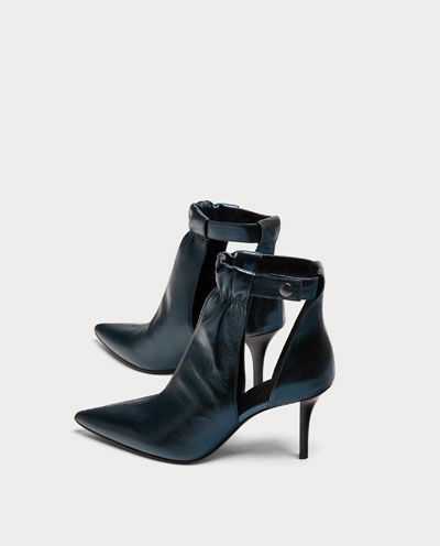 This combo or color, shine, cut-outs and ankle details make these dress booties a must-have to add a little luxury to your wardrobe.