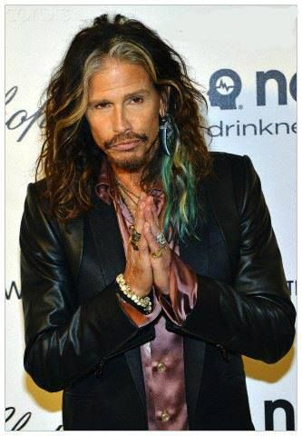 Steven Tyler. I love his hair. And yes I know he's a dude but whatever, I would totally wear my hair like that!