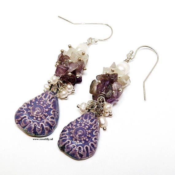 Bekijk dit items in mijn Etsy shop https://www.etsy.com/nl/listing/536589065/paarse-amethist-parel-cluster-oorbellen