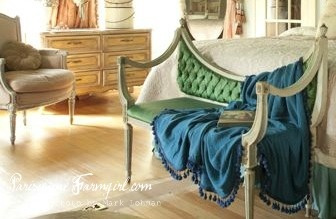 at the foot of the bed, this is a fun shape and blanket tassels!