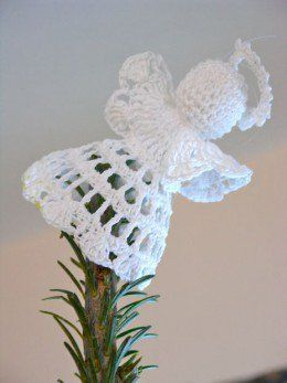 Crochet Angel tipping from the tree                                                                                                                                                      More