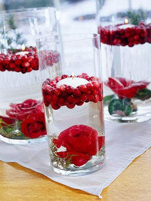Floating candle with flower and cranberries - looooove fruit and flower centerpieces!