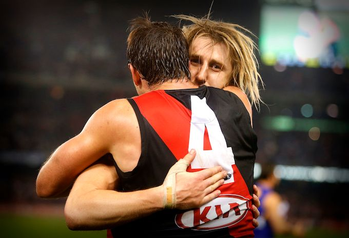 Round 21, 2014 - Jobe and Hepp share a moment after a hard fought win against the West Coast Eagles. #DonTheSash