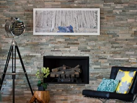 There's an urban vibe to the stone surround of this fireplace. The most popular types of fireplace stone include limestone, granite, marble, slate and travertine. Design by Regina Sirois; Photography by Justin Sirois of Olathe Kansas.