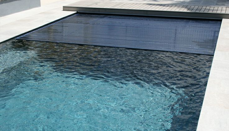 The reflection pool with built in cover swimming pools for Swimming pool dealers