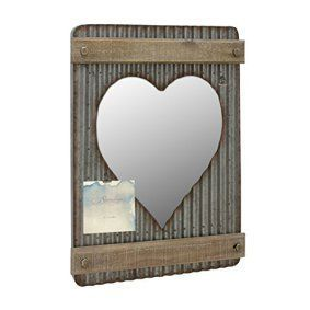 Heart shaped wall décor is trendy, adorable and charming.  You can get all kinds of unique home décor ideas from looking at different pieces of heart wall art décor and come up with something interesting and cute of your own.  I love combining heart wall clocks with abstract metal shaped wall art along with some heart shaped wall décor accents   Stonebriar Corrugated Metal & Wood Heart Shaped Mirror with Attached Wall Hanger and Clip ; Industrial Wall Decor ; Distressed Finish
