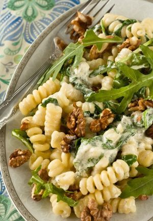 Pasta with blue cheese sauce.This delicious recipe belongs to Fine Italian cuisine.Cooked pasta with arugula,blue cheese sauce and chopped walnuts.Yummy!!!