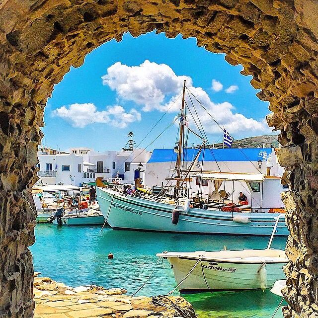 Wonderful Naoussa village , at Paros island (Πάρος) . A perfect picture with Greek traditional fishing boat . Enjoy the summer !