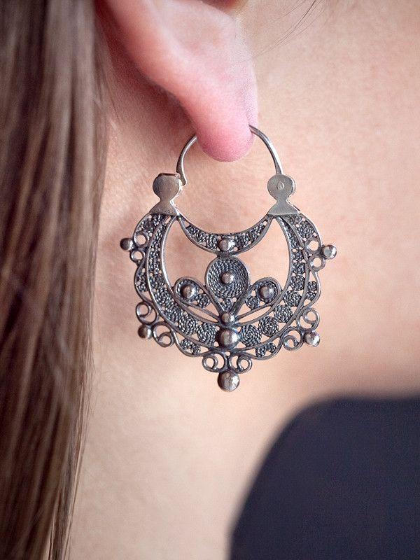 These intricate and elegant Horseshoe Earrings are handcrafted by the Mendez brothers of Luis Mendez Artesanos. They utilize centuries old jewelry techniques for creating this delicate filigree jewelr