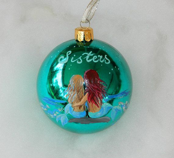 Mermaid Handpainted Ornament Personalized Sisters Gift Sisters Mermaids Ornament Custom Mermaid Sisters Ornament Mermaid Gift, gift for kids-Handpainted Ornament, Mermaid Sisters or Mermaid Friends Christmas Ornament, Personalized Mermaid Ornament, sisters gift Two mermaids with written Sisters above or personalized per request. Two mermaids with light hair and reddish brown, could be different, please contact the shop with your request. This is an original hand painted ornament signed with…