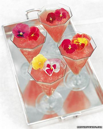 Watermelon Punch  3 cups seeded watermelon, cut into 1 1/2-inch pieces  1 1/2 cups white vermouth  1 1/2 tablespoons superfine sugar  3 cups crushed ice  Edible pansies, for garnish