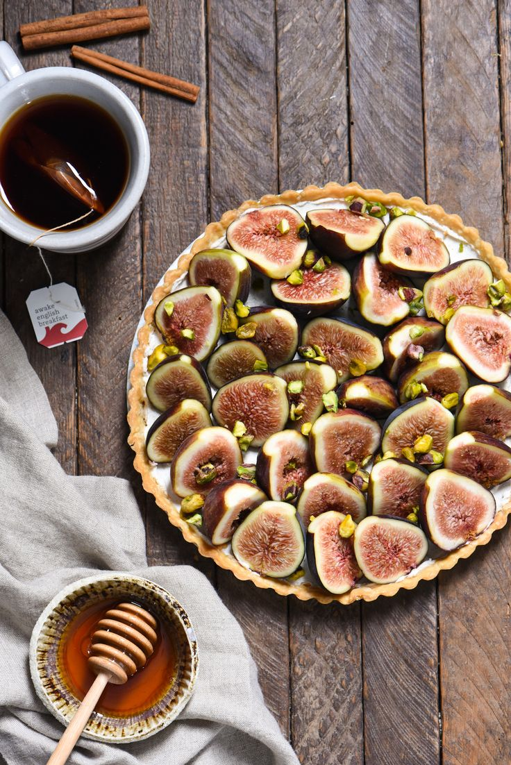 """Fig & Spiced Goat Cheese Tart - A """"dessert"""" for all the cheese lovers out there. Ripe figs are piled into a flaky crust on top of sweet and savory spiced goat cheese, then topped with honey and pistachios. 