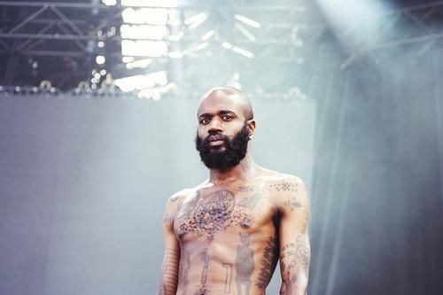 Stefan Burnett of Death Grips.  Death Grips is an American hip hop group from Sacramento, California, United States, formed in 2010. The group consists of rapper Stefan Burnett (better known by his stage name, Ride), drummer Zach Hill, and producer Andy Morin.[6] The band's music has been described as combining hip hop, industrial music, and noise music.[7]
