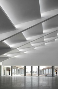 if the black/concrete ceiling is too dark, this could be nice as well - geometric ceiling with diffused lighting. but it wouldn't slope upward since the ceiling is flat, it would just be angled panels..