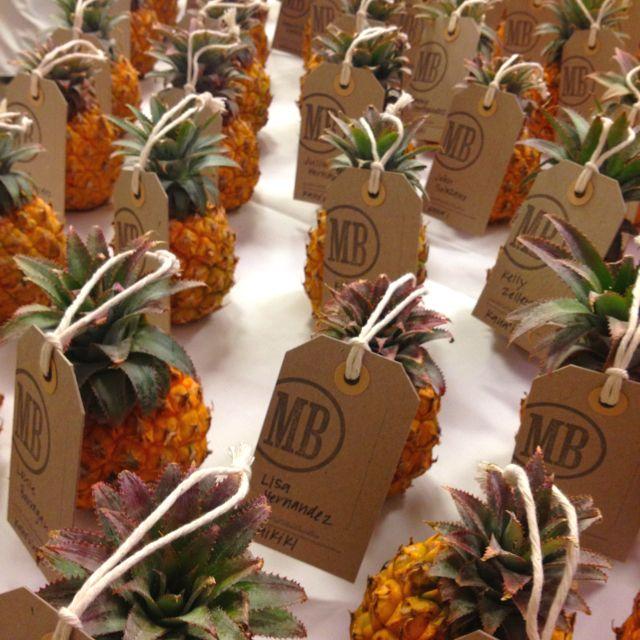 Pineapple seating cards at this hawaiian wedding.