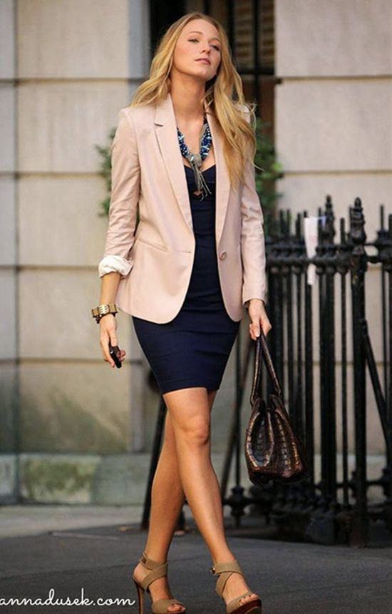A tan blazer over a basic dark dress