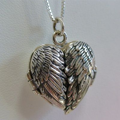 wing heart locket...don't care there's no bling.  I love hearts and I love Angel Wings...sometimes you can't have it all LOL  <3 this!