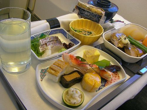 Had a meal like this on United Business Class flight to Narita.  The one portion of Kappa-maki was still frozen, and could have been used as a bullet to bore holes in the cabin.  United has *TERRIBLE* service in their upper classes.