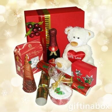 Missing someone special this Christmas? Send them this lovely hamper to show them how much you care. All beautifully presented in a red box with ribbons and bows.  Cute teddy bear Dinky bottle of JC Le Roux sparkling red wine Festive candle Mini Christmas cake 2 x festive crackers Sally Williams almond nougat gift box Festive chocolate balls