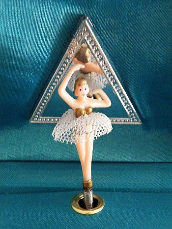 I had one of these Jewelry box ballerinas. I would wind it up and listen forever...