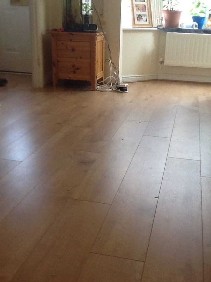 Light Oak Laminate from Magnet Trade, laid through lounge and hallway.  www.ppmsltd.co.uk