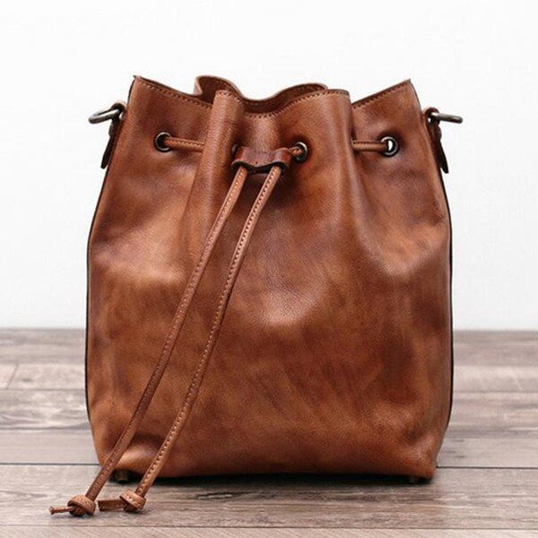 Genuine Leather Messenger Shoulder Bag Cross body Bag Leather Bucket Bag We use genuine cow leather, quality hardware and fabric to make the bag as good as it is. •Comfortable Shoulder Strap. • Inside
