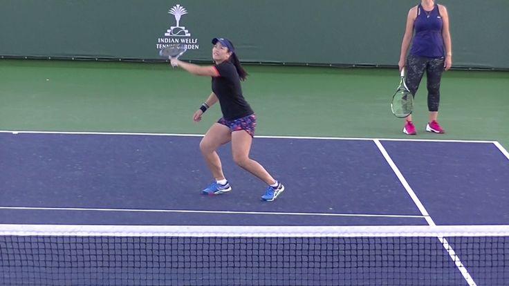 Martina Hingis and Chan Yung-Jan having fun practicing left-handed tenni...