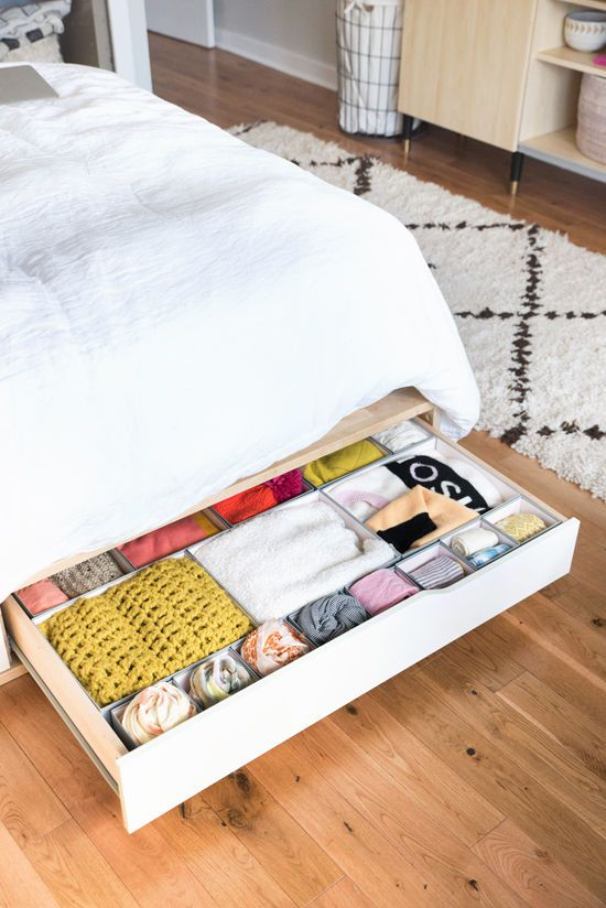 Need more storage space? Utilize under-bed drawers like this MANDAL Bed frame and inserts for smaller clothing.