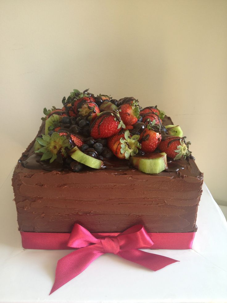White chocolate cake with Dark Chocolate ganache decorated with fruits By http://sugarcloudcakes.com.au