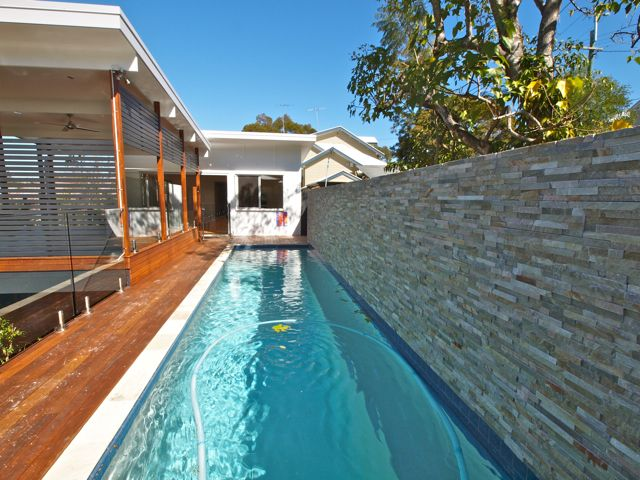 Lap pool & deck.  This is one of my first projects and it is nice to see it finished and the clients happy.  The stone wall provides nice privacy to the the neighbours on this small lot but is also a nice contrast to the timber deck.  The new timber deck has exposed rafters &  frameless glass balustrades.