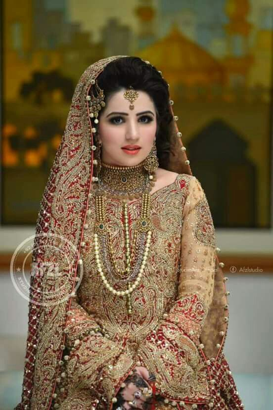 Gorgeous bride with highly weird jewellery  and dress
