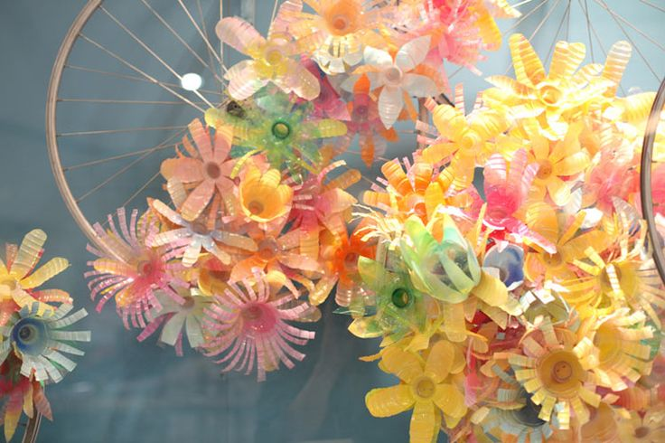 Cheery little flowers made from plastic bottles/ cups-Art made from Recycled stuff is fun and cheap!-Use instead of bows for gifts...