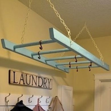 Laundry Ladder  Wondering what to do with that old wooden ladder? Give it a coat of paint in your favorite color and hang it from your ceiling to act as a drying rack, or cut it and mount it to the wall to create a drop-down drying rack.