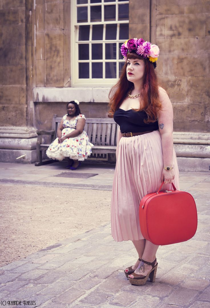 plus size fashion with two beautiful curvy women. I love the red hair of the model in the foreground and the serene look of the one in the background. floral crown for the win too.