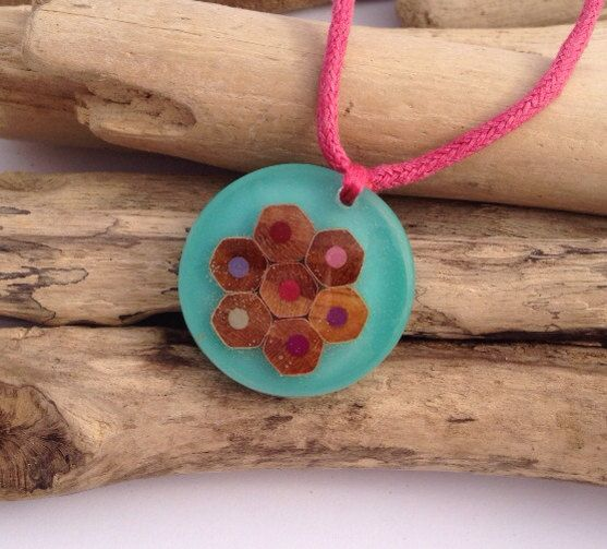 Handcrafted eco-resin pencil pendant in aqua with pinks.