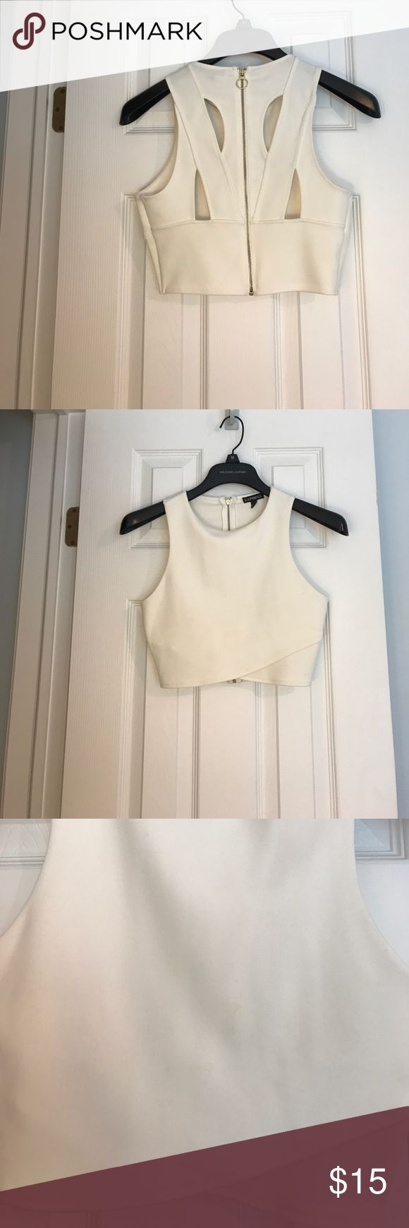 Express crop top White express crop top.. 98% polyester. Small stain on front. Only can see if up really close(see image) probably would come out at a dry cleaner or with some TLC Express Tops Crop Tops