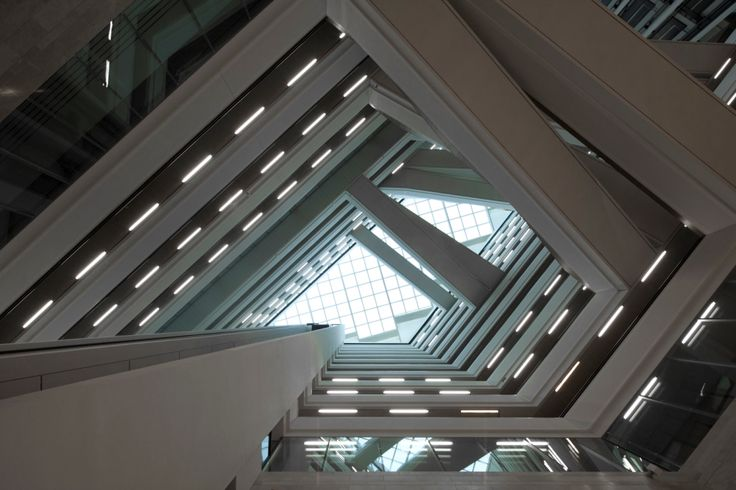 Staircases and glass roof of Der Spiegel HQ in Hamburg, Germany by Henning Larsen Architects. Photo by Cordelia Ewerth