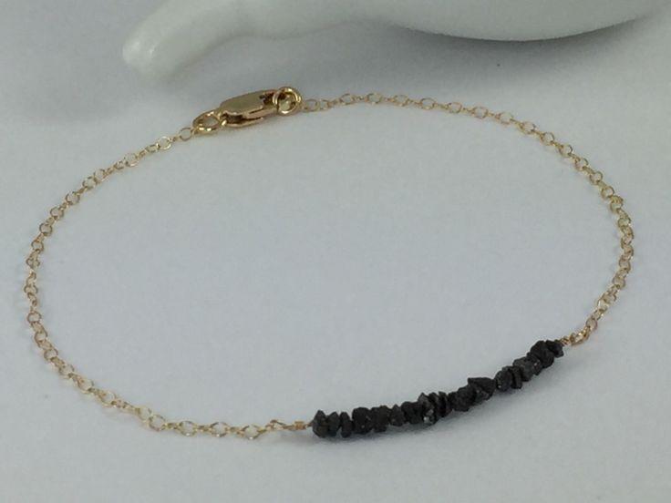 Black Diamond Bracelet, Raw Black Diamond Chip Bracelet in 14K Gold Filled, Delicate Bracelet, Stacking Bracelet, Layering Bracelet by WhiteOrchidJewelry on Etsy https://www.etsy.com/listing/245966443/black-diamond-bracelet-raw-black-diamond