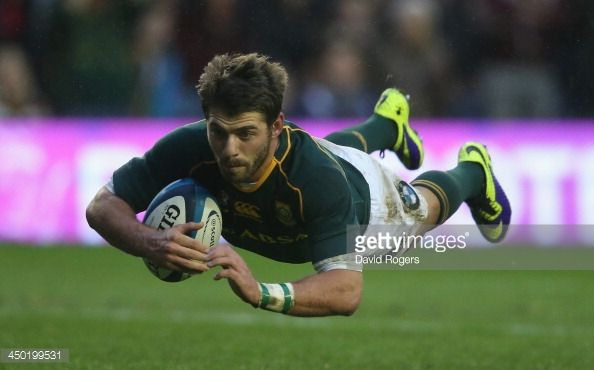 News Photo : Willie Le Roux of South Africa dives over for a...