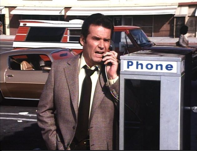 Jim on a pay phone.