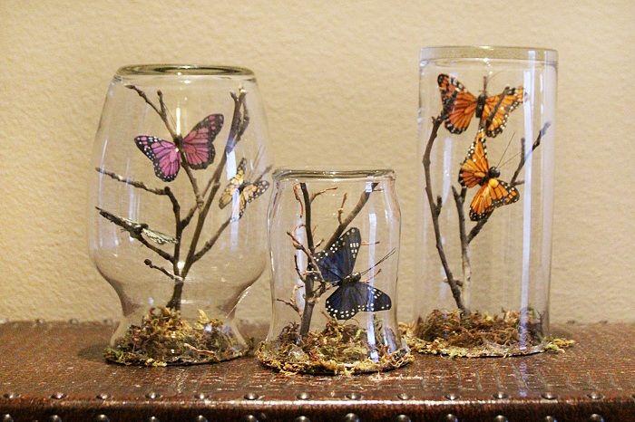 Симпатичное украшение комнаты при помощи таких необычных баночек с ветками и бабочками.