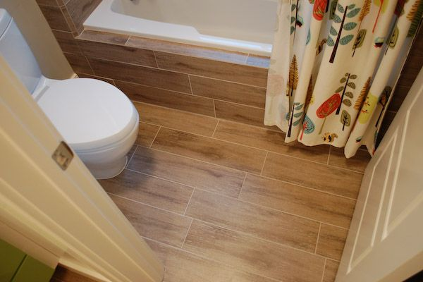 bathroom tile floor ideas for small bathrooms using wood look ceramic tile to create shower walls 25941 | 9fdd018043c471d8442d03ae58bea500
