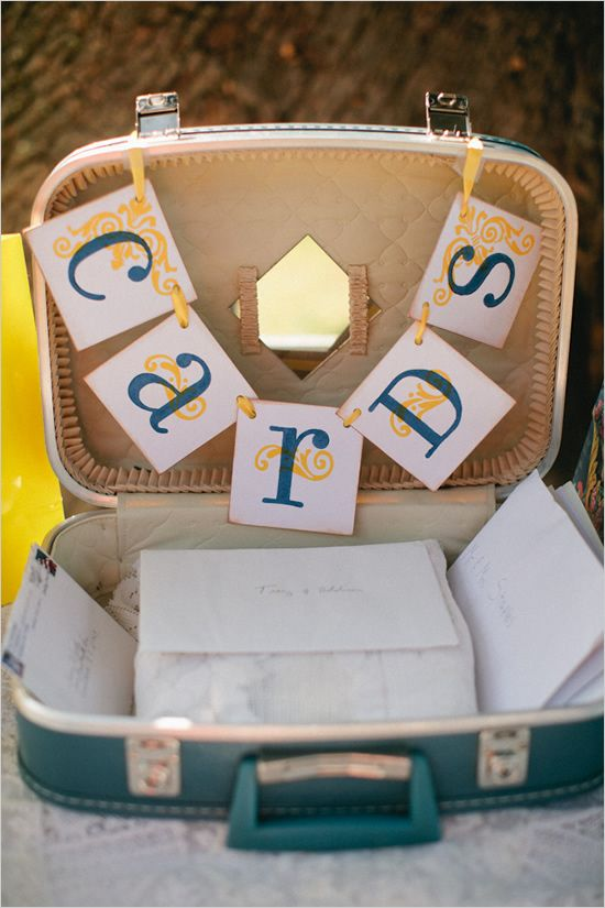Suitcase as box for wedding cards at gift table @Jenna Nelson McClure This totally reminds me of that suitcase you carted to Hawaii that one year! haha maybe something like it would work for your vintage theme...