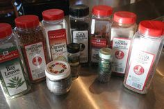 Spices for corned beef. Bay leaves, coriander seed, mustard seeds in small jar, caraway seed, white peppercorns, black pepper, cinnamon sticks, allspice, whole cloves and fennel seed.