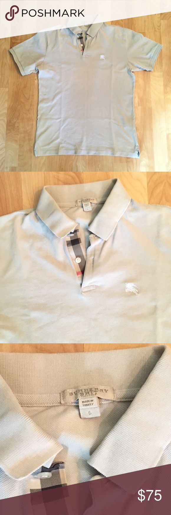 BURBERRY polo shirt Classic beige authentic Burberry Brit polo shirt with Burberry plaid accent on placket. Very good pre-owned condition. Burberry Shirts Polos