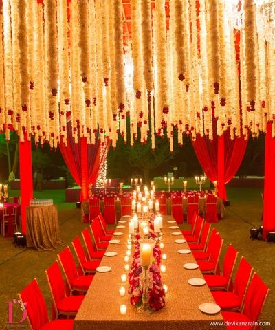 hanging flowers from ceiling , red and gold table centerpieces , mogra flowers, hanging florals , glamorous wedding day decor