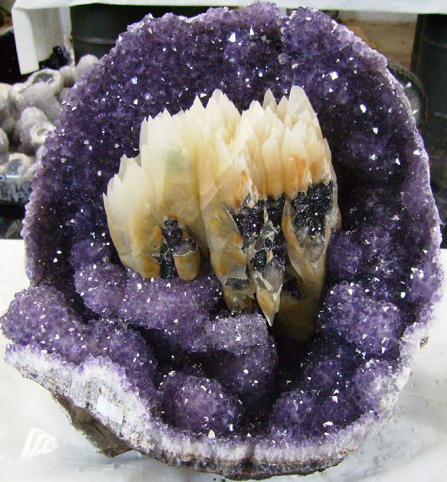 Uruguay Minerals - Amethyst & Calcite crystals in geode